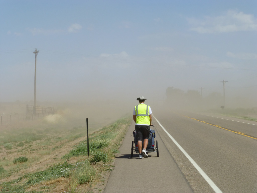 Mike walks bravely into the dust storm